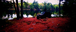 Jeep Rubicon on red lake shore